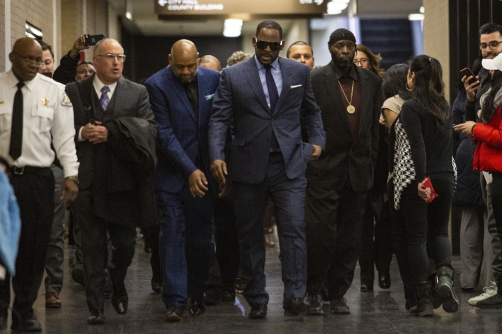 Musician R. Kelly arrives at the Daley Center for a hearing in his child support case at the Daley Center, Wednesday, March 6, 2019, in Chicago. Kelly was charged last month with sexually abusing four females dating back to 1998, including three underage girls. He's pleaded not guilty. (Ashlee Rezin/Chicago Sun-Times via AP)/Chicago Sun-Times via AP)