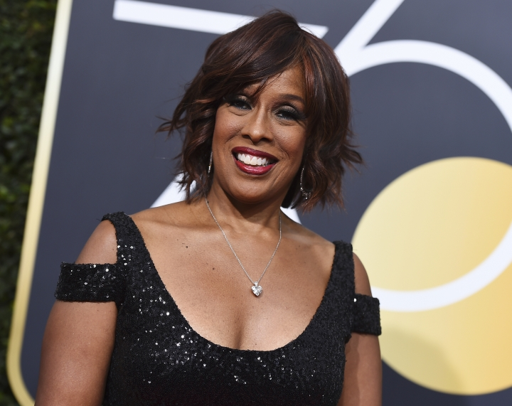 """FILE - In this Jan. 7, 2018, file photo, Gayle King arrives at the 75th annual Golden Globe Awards at the Beverly Hilton Hotel in Beverly Hills, Calif. CBS' King proves unflappable during an emotional interview with R&B star R. Kelly that aired on """"CBS This Morning."""" King's composure with an emotional R. Kelly about the sex abuse charges against him may have garnered more attention than his comments on the matter. (Photo by Jordan Strauss/Invision/AP, File)"""