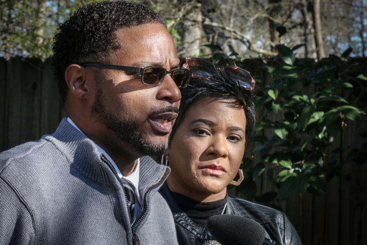 Timothy Savage, left, and his wife Jonjelyn Savage discuss their daughter's relationship with R&B singer R. Kelly at a press conference with their attorney on Wednesday, March 6, 2019, in Decatur, Ga. The family claims they haven't seen their daughter, Joycelyn Savage, for years and blame Kelly for maintaining a cult-like influence over her. The recording artist has been trailed for decades by allegations that he violated underage girls and women and held some as virtual slaves. (AP Photo/Ron Harris)