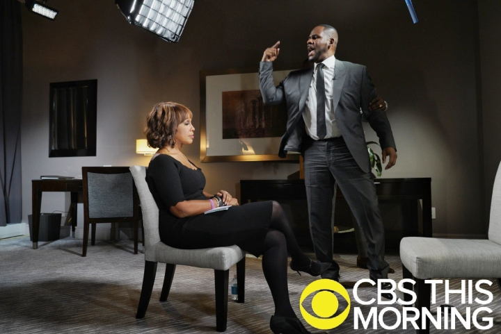 "In this March 5, 2019 photo provided by CBS, R&B singer R. Kelly gestures while making a point during an interview with Gayle King on ""CBS This Morning"" broadcast. The R&B singer gave his first interview since being charged last month with sexually abusing four females dating back to 1998, including three underage girls. Kelly has pleaded not guilty to 10 counts of aggravated sexual abuse. (Lazarus Jean-Baptiste/CBS via AP)"