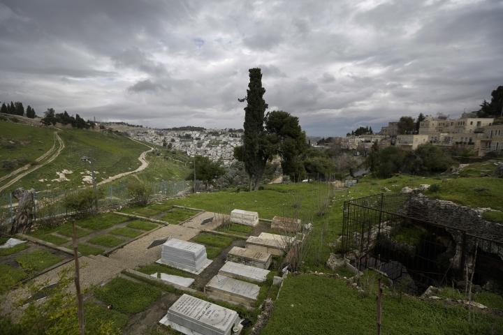 This Saturday, March 2, 2019 photo, shows the Karaite cemetery in Jerusalem. The Karaite Jewish community, a tiny religious sect, is emerging as a major impediment for a controversial plan to connect modern Jerusalem and its historic Old City with a cable car network. Other objections -- from Palestinian residents, environmentalists, urban planners and archaeologists -- have so far been unable to halt the project. But the Karaite's concern that the cable car will desecrate its ancient cemetery may provide the biggest hurdle of all to government planners. (AP Photo/Dusan Vranic)