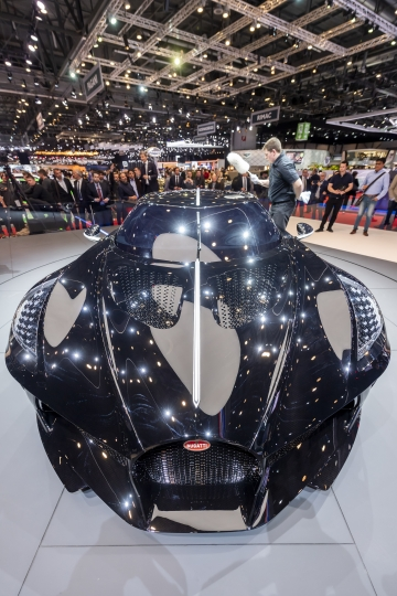 The New car Bugatti La voiture Noire is presented during the press day at the '89th Geneva International Motor Show' in Geneva, Switzerland, Tuesday, March 5, 2019. The 'Geneva International Motor Show' takes place in Switzerland from March 7 until March 17, 2019. Automakers are rolling out new electric and hybrid models at the show as they get ready to meet tougher emissions requirements in Europe - while not forgetting the profitable and popular SUVs and SUV-like crossovers. (Martial Trezzini/Keystone via AP)