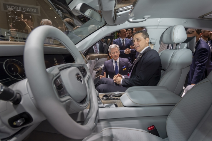 Foreign Minister Ignazio Cassis sits in an Aurus Senat car during the opening of the 89th Geneva International Motor Show, in Geneva, Switzerland, Thursday, March 7, 2019. The Motor Show will open its gates to the public from 7 to 17 March presenting more than 180 exhibitors and more than 100 world and European premieres. (Martial Trezzini/Keystone via AP)