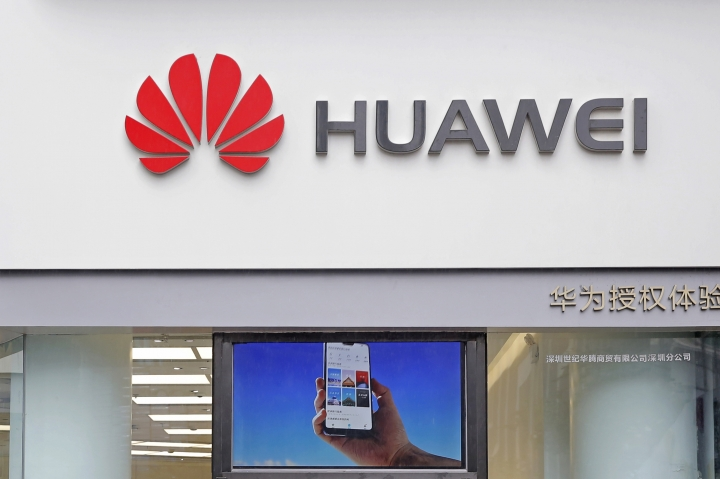 A logo of Huawei is displayed at a shop in Shenzhen, China's Guangdong province, Thursday, March 7, 2019. Chinese tech giant Huawei is challenging a U.S. law that labels the company a security risk and would limit its access to the American market for telecom equipment. (AP Photo/Kin Cheung)