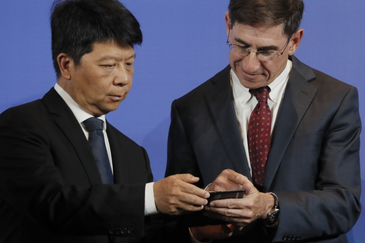 Huawei Rotating Chairman Guo Ping, left, chats with Glen Nager, Partner at Jones Day during a press conference in Shenzhen city, China's Guangdong province, Thursday, March 7, 2019. Chinese tech giant Huawei is launching a U.S. court challenge to a law that labels the company a security risk and would limit its access to the American market for telecom equipment. (AP Photo/Kin Cheung)