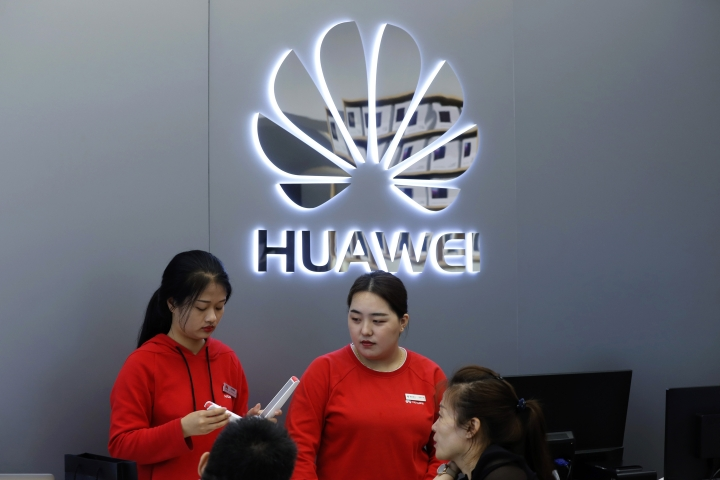 Shop assistants talk to customers in a Huawei retail shop in Shenzhen, China's Guangdong province, Thursday, March 7, 2019. Chinese tech giant Huawei is challenging a U.S. law that labels the company a security risk and would limit its access to the American market for telecom equipment. (AP Photo/Kin Cheung)