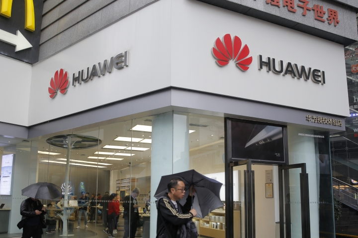 A man walks past a Huawei retail shop in Shenzhen, China's Guangdong province, Thursday, March 7, 2019. Chinese tech giant Huawei is challenging a U.S. law that labels the company a security risk and would limit its access to the American market for telecom equipment. (AP Photo/Kin Cheung)