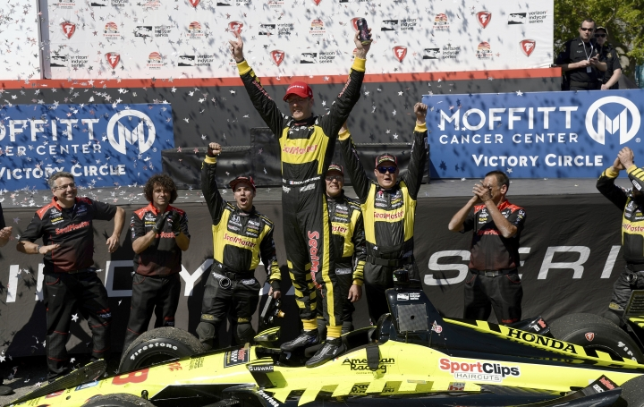 FILE - In this March 11, 2018, file photo, Sebastien Bourdais celebrates after winning the IndyCar Firestone Grand Prix of St. Petersburg, in St. Petersburg, Fla. St. Petersburg has been good to Bourdais, and he in turn is the unofficial ambassador for IndyCar's season-opening event. The Frenchman will be seeking his third consecutive victory Sunday, March 10, 2019, on the 1.8-mile course through the picturesque downtown of Bourdais' adopted hometown. (AP Photo/Jason Behnken, File)