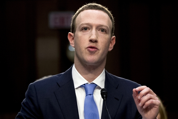 FILE - In this April 10, 2018, file photo, Facebook CEO Mark Zuckerberg testifies before a joint hearing of the Commerce and Judiciary Committees on Capitol Hill in Washington, about the use of Facebook data to target American voters in the 2016 election. Zuckerberg said Facebook will start to emphasize new privacy-shielding messaging services, a shift apparently intended to blunt both criticism of the company's data handling and potential antitrust action. (AP Photo/Andrew Harnik, File)