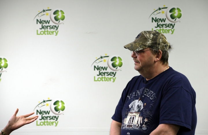 Mike Weirsky is interviewed following a news conference Thursday, March 7, 2019 in Trenton, NJ. Weirsky, a New Jersey man who almost forgot his $273 million jackpot-winning Mega Millions lottery ticket at the store where he bought it says he's going to reward whoever returned it. (AP Photo/Jacqueline Larma)
