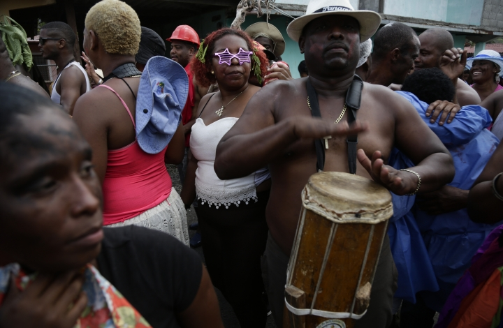 "A man plays his drum, alerting residents to the start of the ""Diablos y Congos"" event, an Ash Wednesday ritual that marks the end of Carnival and the start of the Lenten season in Nombre de Dios, Panama, Wednesday, March 6, 2019. The ritual has been recognized as Intangible Cultural Heritage by UNESCO. (AP Photo/Arnulfo Franco)"
