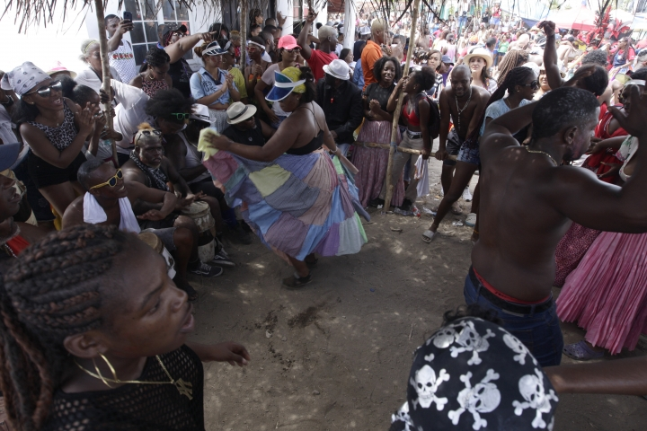 "Men play drums for dancers at the ""Castle"" during the ""Diablos y Congo,"" an Ash Wednesday ritual that marks the end of Carnival and the start of the Lenten season in Nombre de Dios, Panama, Wednesday, March 6, 2019. The ritual has been recognized as Intangible Cultural Heritage by UNESCO. (AP Photo/Arnulfo Franco)"