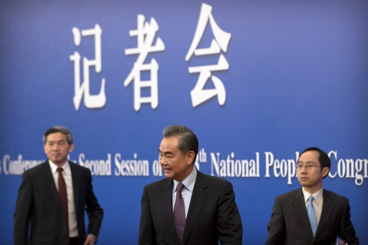 """Chinese Foreign Minister Wang Yi, center, leaves after a press conference on the sidelines of the annual meeting of China's National People's Congress (NPC) in Beijing, Friday, March 8, 2019. The U.S.-North Korea summit in Vietnam last week was an """"important step"""" toward denuclearization on the Korean peninsula, China's foreign minister said Friday. (AP Photo/Mark Schiefelbein)"""