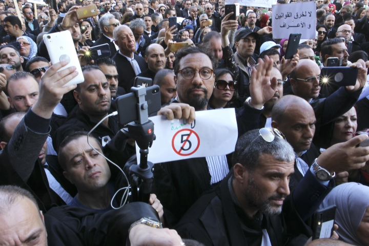 Algerian lawyers gather outside the constitutional council in a protest against President Abdelaziz Bouteflika, Thursday March 7, 2019 in Algiers. The Algerian leader, in power since 1999 and all but invisible since a stroke in 2013, is running for a fifth term. (AP Photo/Anis Belghoul)