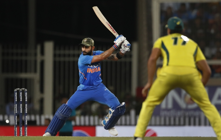 India's captain Virat Kohli, left, bats during the third one day international cricket match between India and Australia in Ranchi, India, Friday, March 8, 2019. (AP Photo/Aijaz Rahi)
