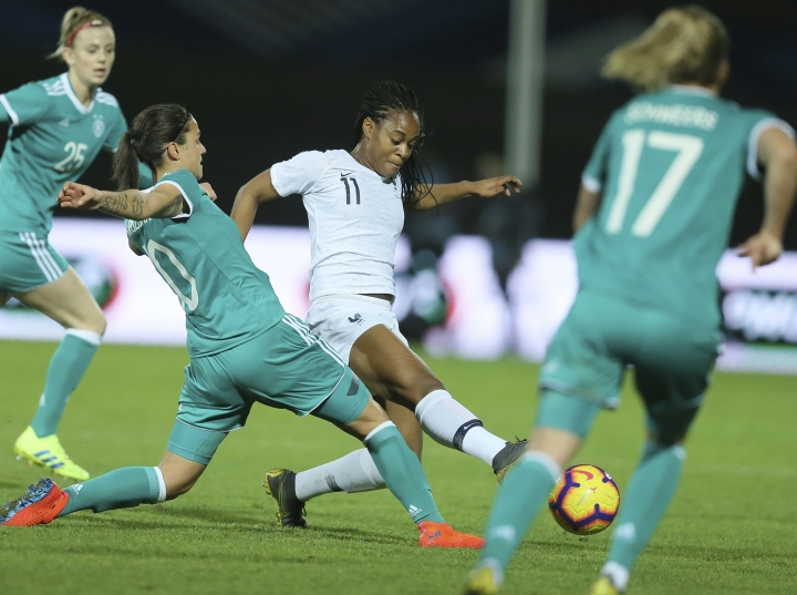Germany's Dzsenifer Marozsan, left, and France's Marie-Antoinette Katoto challenge for the ball during a women's international friendly soccer match between France and Germany at Francis-le-Basser stadium in Laval, western France, Thursday, Feb. 28, 2019. (AP Photo/David Vincent)