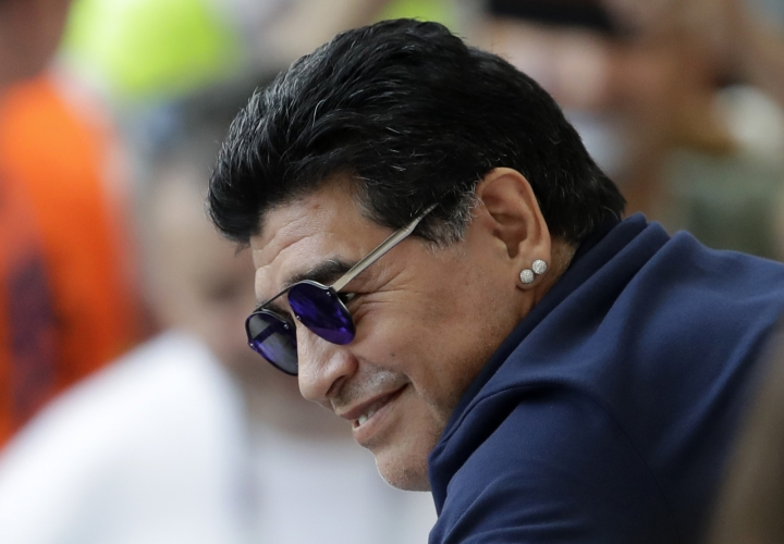 FILE - In this June 30, 2018 file photo, Argentinian soccer legend Diego Armando Maradona smiles prior to a match at the 2018 soccer World Cup in the Kazan Arena, in Kazan, Russia. Maradona's lawyer said Friday, March 8, 2019, that the former soccer star and current coach of Mexican club Dorados of Sinaloa will legally recognize three children that he fathered in Cuba. (AP Photo/Sergei Grits, File)