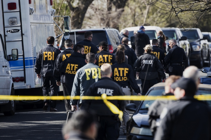 FILE - In this March 12, 2018 file photo, authorities work on the scene of an explosion in Austin, Texas. Recordings of several 911 calls made after a series of deadly package bombings in Austin last year show the chaos and panic that gripped the city. (Ricardo B. Brazziell/Austin American-Statesman via AP)