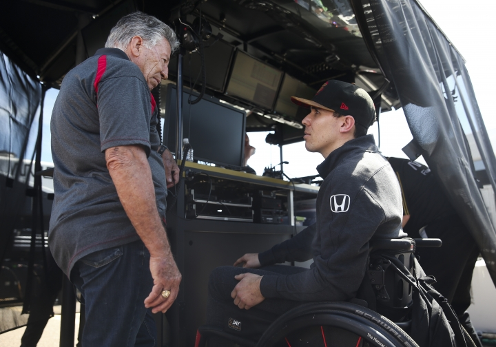 Auto Racing legend Mario Andretti, left, talks with Robert Wickens at the IndyCar Grand Prix of St. Petersburg auto race in St. Petersburg, Fla., Friday, March 8, 2019. Wickens returned to a race track for the first time since he suffered a major spinal cord injury in a crash six months ago. (Dirk Shadd/Tampa Bay Times via AP)