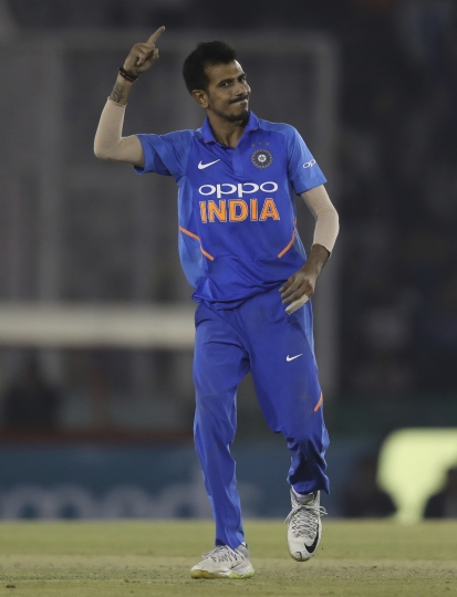 India's Yuzvendra Chahal celebrates the dismissal of Australia's Peter Handscomb during the fourth one day international cricket match between India and Australia in Mohali, India, Sunday, March 10, 2019. (AP Photo/Altaf Qadri)