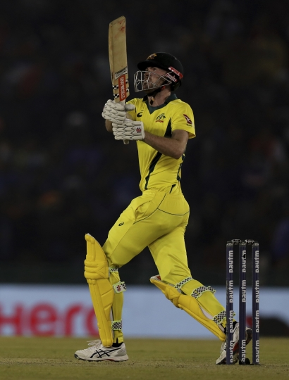 Australia's Ashton Turner watches the ball after hitting it for a six during the fourth one day international cricket match between India and Australia in Mohali, India, Sunday, March 10, 2019. (AP Photo/Altaf Qadri)