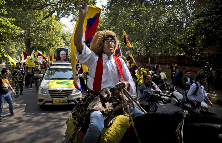 A horse mounted exile Tibetan shouts slogans during a march to mark the 60th anniversary of the March 10, 1959 Tibetan Uprising Day, in New Delhi, India, Sunday, March 10, 2019. The uprising of the Tibetan people against the Chinese rule was brutally quelled by Chinese army forcing the spiritual leader the Dalai Lama and thousands of Tibetans to come into exile. Every year exile Tibetans mark this day as the National Uprising Day. (AP Photo/Manish Swarup)