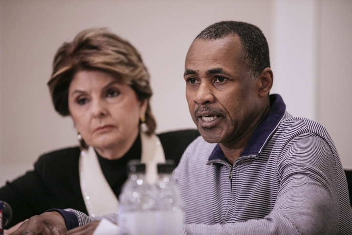Gary Dennis, seated with Lawyer Gloria Allred, speaks during a press conference announcing a video tape said to present further evidence of wrongdoing by recording artist R. Kelly Saturday, March 10, 2019, in New York. Dennis said the tape, which he found at his home in Pennsylvania, shows R. Kelly sexually abusing more than one underage girl. (AP Photo/Kevin Hagen)