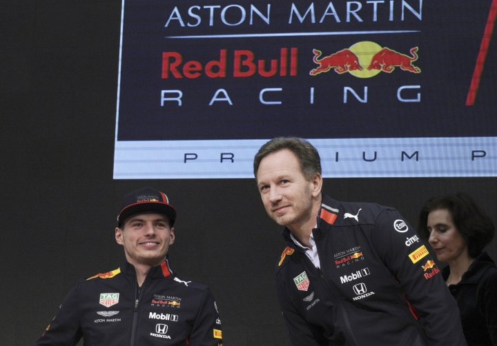 Formula One Red Bull driver Max Verstappen, left, of the Netherlands and his team manager Christian Horner attend a Honda F1 promotional event Saturday, March 9, 2019, in Tokyo. (AP Photo/Eugene Hoshiko)