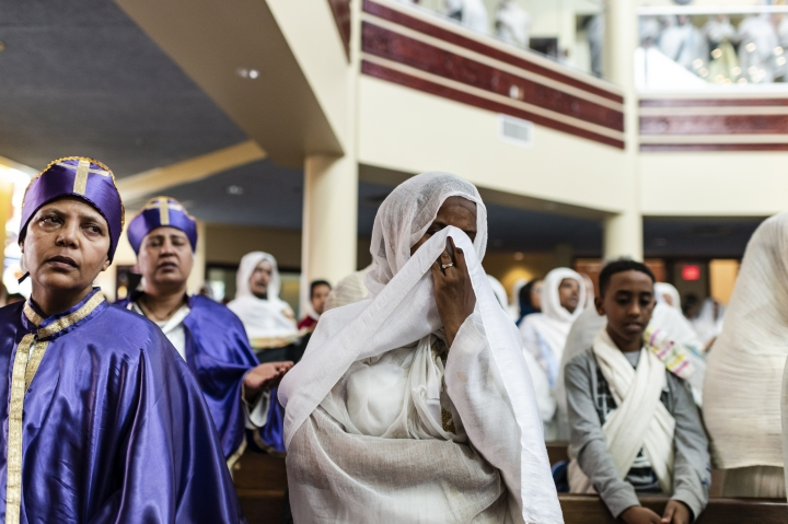Members of the Ethiopian community take part in a special prayer for the victims of the Ethiopian Airlines flight ET302 crash, at the Ethiopian Orthodox Tewahedo Church of Canada Saint Mary Cathedral in Toronto, on Sunday, March 10, 2019. Ethiopian Airlines flight ET302 crashed shortly after takeoff from Ethiopia's capital on Sunday morning, killing all 157 on board, authorities said, including 18 Canadians. (Christopher Katsarov/The Canadian Press via AP)