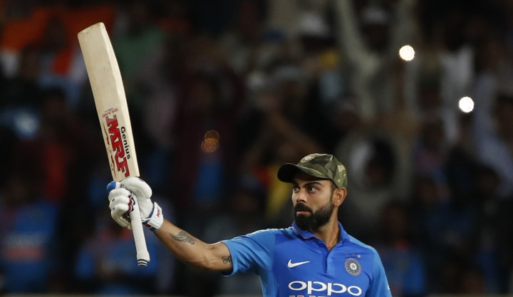 India's captain Virat Kohli raises his bat to celebrate scoring a century during the third one day international cricket match between India and Australia in Ranchi, India, Friday, March 8, 2019. (AP Photo/Aijaz Rahi)