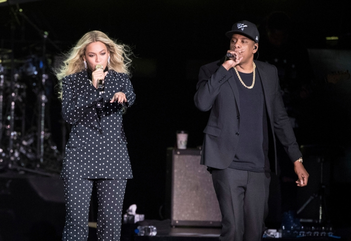FILE - In this Nov. 4, 2016 file photo, Beyonce and Jay-Z perform during a Democratic presidential candidate Hillary Clinton campaign rally in Cleveland. The power couple will be honored for accelerating LGBTQ acceptance at the GLAAD Media Awards on March 28. (AP Photo/Matt Rourke, File)