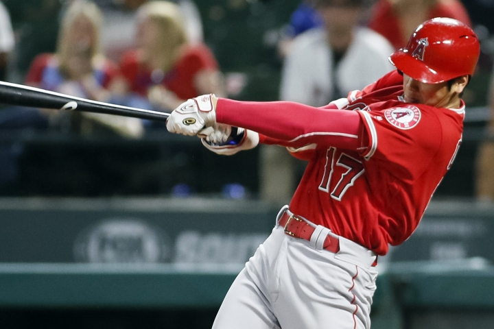 FILE - In this Sept. 5, 2018, file photo, Los Angeles Angels' Shohei Ohtani follows through on a two-run home run against the Texas Rangers during the eighth inning of a baseball game in Arlington, Texas. Ohtani got a modest raise from the Angels after winning the AL Rookie of the Year award, agreeing to a one-year contract that boosts his pay to $650,000 from last year's minimum of $545,000. (AP Photo/Ray Carlin, File)