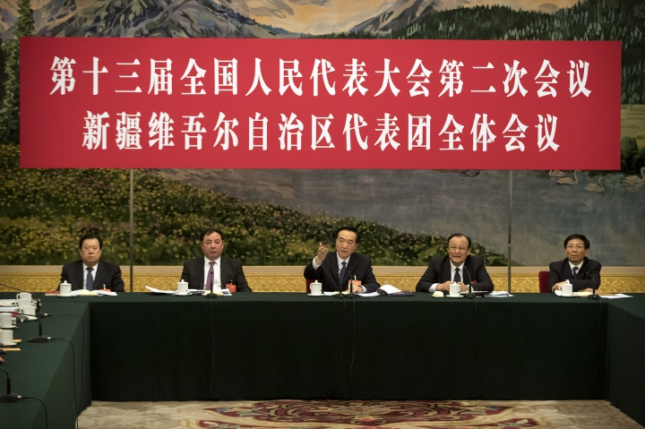 "Chen Quanguo, center, Communist Party secretary of China's Xinjiang Uighur Autonomous Region, gestures while speaking during a group discussion meeting on the sidelines of China's National People's Congress (NPC) at the Great Hall of the People in Beijing, Tuesday, March 12, 2019. China says heavily guarded internment camps for Muslims which it calls vocational training centers will ""gradually disappear"" if there comes a day that ""society does not need"" them. The banner reads ""The 13th National People's Congress, 2nd session, Xinjiang Uighur Autonomous Region delegation group discussion session."" (AP Photo/Mark Schiefelbein)"