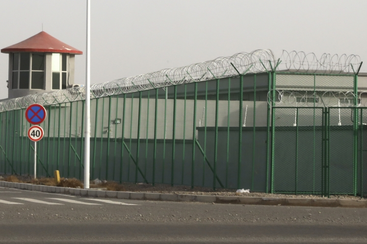 "FILE - In this Monday, Dec. 3, 2018, file photo, a guard tower and barbed wire fences surround an internment facility in the Kunshan Industrial Park in Artux in western China's Xinjiang region. A U.S. envoy on religion has described China's internment of an estimated 1 million Muslims as a ""horrific situation."" Ambassador-at-large Sam Brownback called for an independent investigation into the detentions and the release of those being held. (AP Photo/Ng Han Guan/file)"