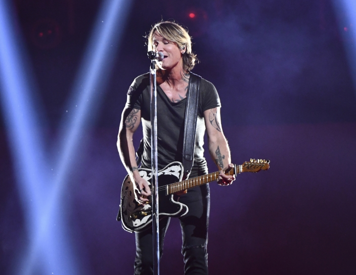 FILE - This Nov. 14, 2018 file photo shows Keith Urban performing at the 52nd annual CMA Awards in Nashville, Tenn. Urban will headline with The Killers and Foo Fighters at The Pilgrimage Music and Cultural Festival in Franklin, Tennessee, about 20 miles south of Nashville, on Sept. 21-22. (Photo by Charles Sykes/Invision/AP, File)