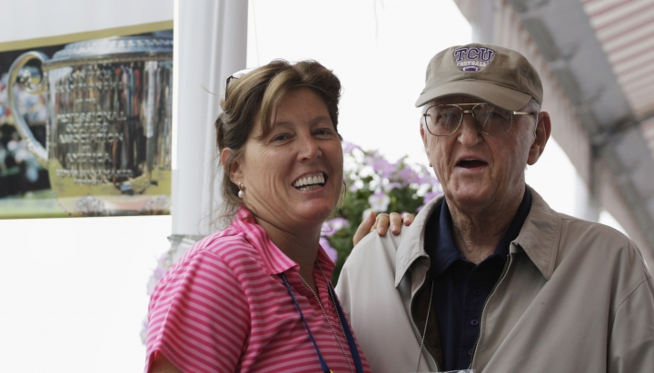 FILE - In this Aug. 15, 2009, file photo, sports writer Dan Jenkins, right, stands next to his daughter, Sally Jenkins, at the PGA Championship at Hazeltine National Golf Club in Chaska, Minn. Jenkins, the sports writing great and best-selling author known for his humor, has died. He was 89. TCU athletic director Jeremiah Donati confirmed Jenkins died Thursday, March 7, 2019, in his hometown of Fort Worth, Texas. (AP Photo/Jeff Roberson, File)