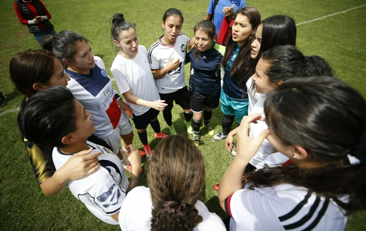 Players who have played in the women's soccer league gather prior to an exhibition match to push for the continuation of the professional women's soccer league in Bogota, Colombia, Saturday, March 9, 2019. Amid sexual harassment complaints against two coaches, and claims of gender discrimination in the national team, soccer officials contemplate cancelling the local women's' league, due to its poor economic performance. (AP Photo/Fernando Vergara)