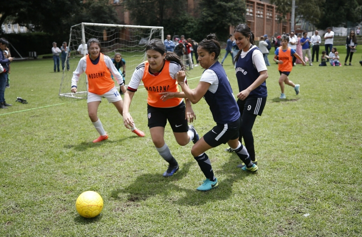 Players who have played in the women's soccer league vie for the ball during an exhibition match to push for the continuation of the professional women's soccer league in Bogota, Colombia, Saturday, March 9, 2019. News that the recently created professional league could be cancelled capped a turbulent month for women's soccer in this country. (AP Photo/Fernando Vergara)