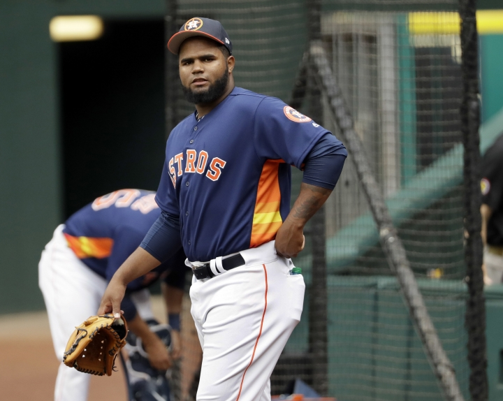 FILE - In this June 9, 2017, file photo, Houston Astros pitcher Francis Martes waits to warm up before a baseball against the Los Angeles Angeles in Houston. Martes has been suspended for 80 games following a positive test for the banned performance-enhancing drug Clomiphene, the league announced Tuesday, March 1, 2019. (AP Photo/David J. Phillip, File)