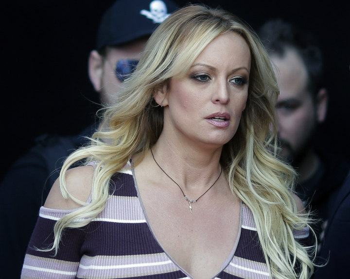 "FILE - In this Oct. 11, 2018, file photo, adult film actress Stormy Daniels arrives at the adult entertainment fair ""Venus"" in Berlin. The 2018 arrest of Daniels at an Ohio strip club was improper but not planned ahead of time or politically motivated, according to an internal police department review released Friday, March 8, 2019. (AP Photo/Markus Schreiber, File)"