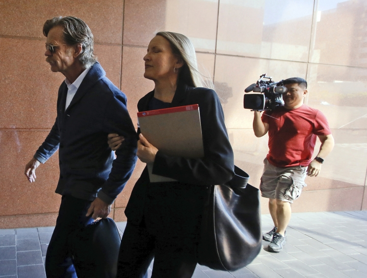 Actor William H. Macy arrives at the federal courthouse in Los Angeles, on Tuesday, March 12, 2019. Fifty people, including Macy's wife, actress Felicity Huffman and actress Lori Loughlin, were charged Tuesday in a scheme in which wealthy parents allegedly bribed college coaches and other insiders to get their children into some of the nation's most elite schools. Macy was not charged; authorities did not say why. (AP Photo/Alex Gallardo)