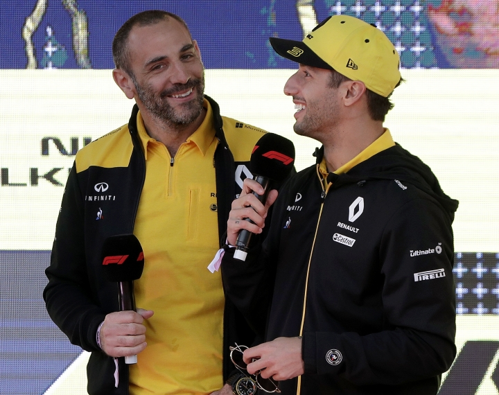 Renault driver Daniel Ricciardo of Australia, right, talks as team principal Cyril Abiteboul listens during the launch for the Australian Grand Prix in Melbourne, Australia, Wednesday, March 13, 2019. (AP Photo/Rick Rycroft)