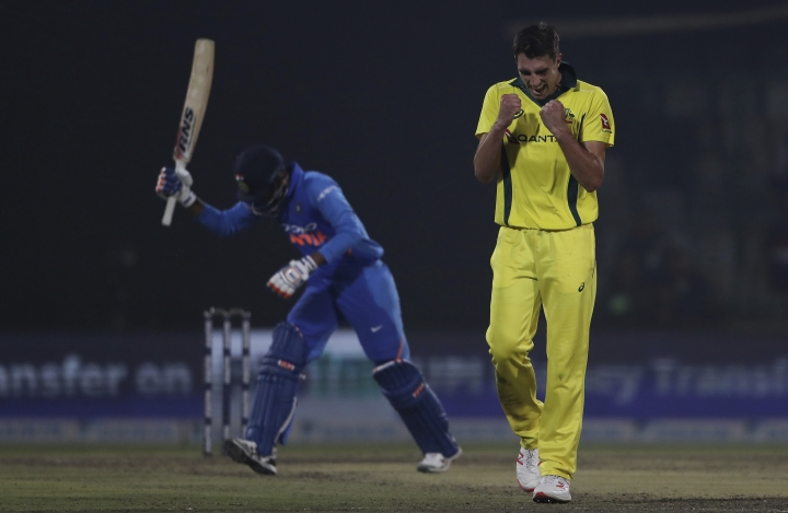 Australia's Pat Cummins celebrates the wicket of India's Kedar Jadhav during the final one day international cricket match between India and Australia in New Delhi, India, Wednesday, March 13, 2019. (AP Photo/Altaf Qadri)