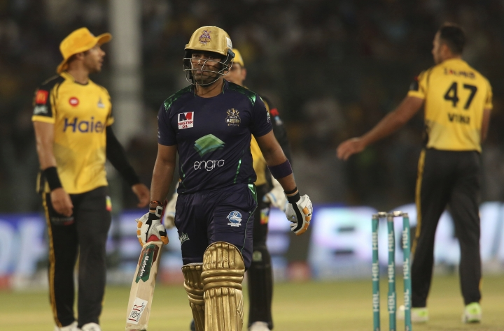 Quetta Gladiators' batsman Umar Akmal on his way pavilion losing his wickets against Peshawar Zalmi in the Pakistan Super League playoff at National Stadium in Karachi, Pakistan, Wednesday, March 13, 2019. (AP Photo/Fareed Khan)