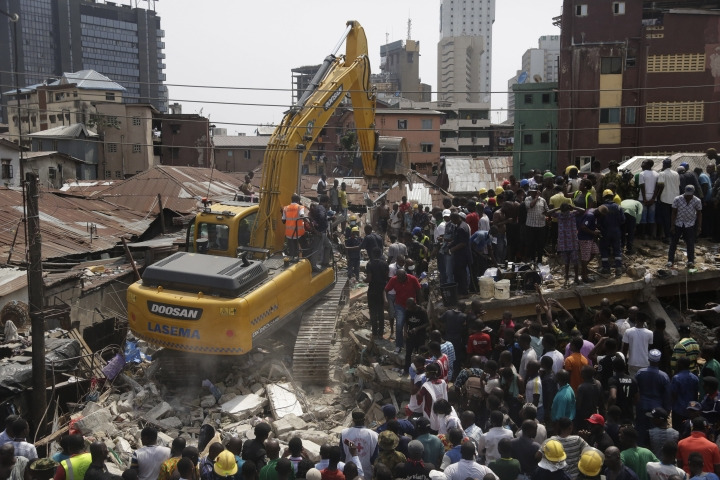 Emergency services attend the scene after a building collapsed in Lagos, Nigeria, Wednesday March 13, 2019. Rescue efforts are underway in Nigeria after a three-storey school building collapsed while classes were in session, with some scores of children thought to be inside at the time. (AP Photo/Sunday Alamba)