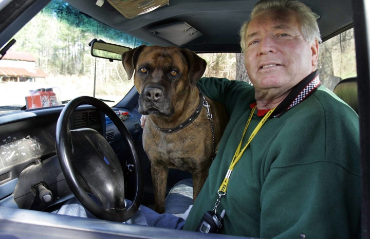 FILE - In this Jan. 11, 2007, file photo, Sam Ard sits in his car with his dog Putt Putt in Pamplico, S.C. Ard, a two-time Xfinity Series champion, was nominated for induction into the NASCAR Hall of Fame on Wednesday, March 13, 2019. (AP Photo/Mary Ann Chastain, File)