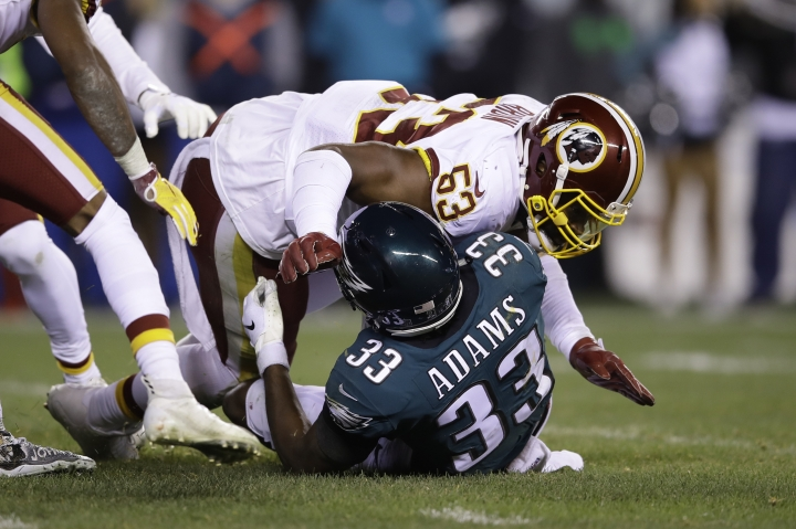 FILE - In this Monday, Dec. 3, 2018, file photo, Philadelphia Eagles' Josh Adams (33) is tackled by Washington Redskins' Zach Brown (53) on fourth down during the first half of an NFL football game, in Philadelphia. On Wednesday, March 13, 2019, the Redskins released linebacker Zach Brown and defensive lineman Stacy McGee as part of a remaking of their defense. (AP Photo/Matt Rourke, File)