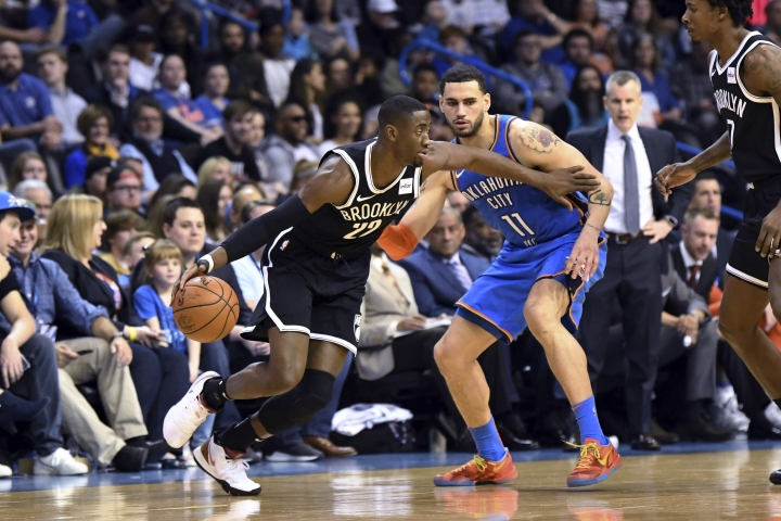 Brooklyn Nets guard Caris LeVert (22) drives past Oklahoma City Thunder forward Abdel Nader (11) during the first half of an NBA basketball game Wednesday, March 13, 2019, in Oklahoma City. (AP Photo/June Frantz Hunt)