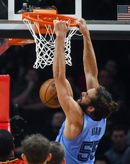 Memphis Grizzlies center Joakim Noah dunks during the second quarter of an NBA basketball game against the Atlanta Hawks, Wednesday, March 13, 2019, in Atlanta. (AP Photo/John Amis)