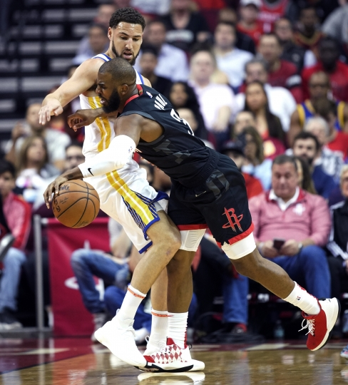 Houston Rockets' Chris Paul (3) is fouled by Golden State Warriors' Klay Thompson during the first half of an NBA basketball game, Wednesday, March 13, 2019, in Houston. (AP Photo/David J. Phillip)